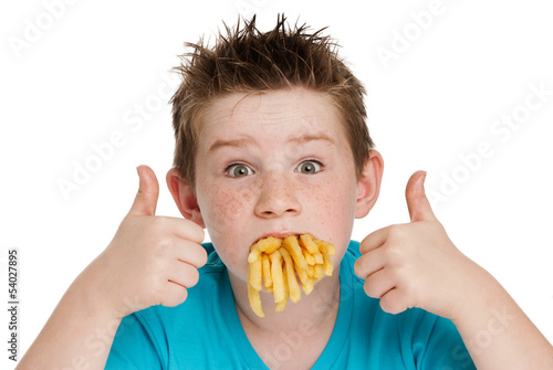 Valokuva  Young Boy with Mouth Full of Chips