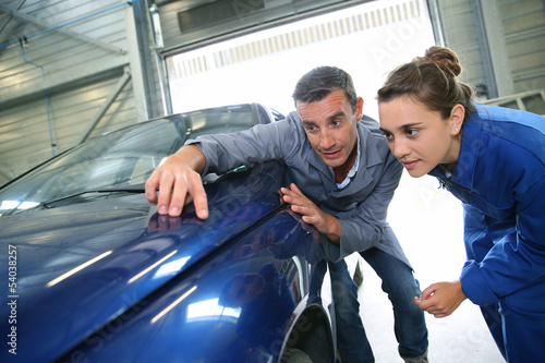 Student with teacher looking at bodywork Canvas Print