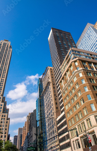 Giant skyscrapers of New York City on a beautiful summer day