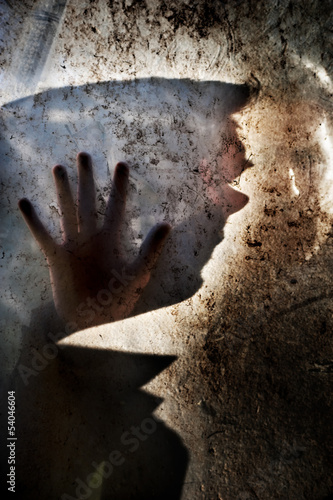 Photo  Man behind dirty window