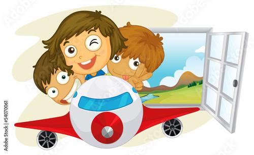 Deurstickers Vliegtuigen, ballon Happy children riding on a jetplane