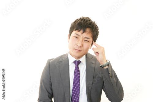 Photo 苦悩するビジネスマン