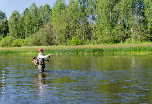 Foto op Canvas Vissen Fisherman catches of chub fly fishing in the Chusovaya river