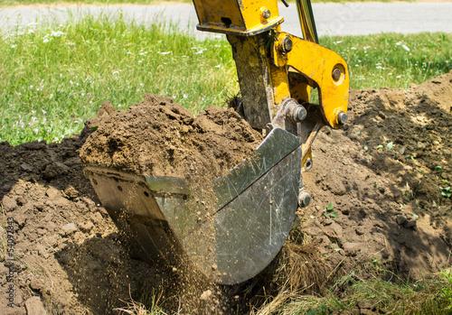 dredger diging with bucket Fototapet