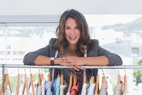 Fotografia, Obraz  Fashion designer leaning on clothes