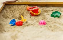 Children's Toys In The Sandbox