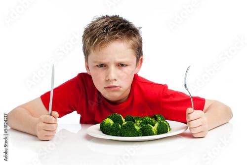 Fotografie, Obraz  Handsome Young Boy Eating Broccoli