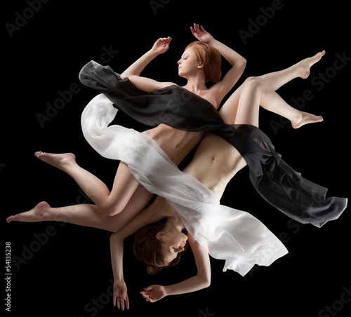 Concept of yin and yang. Sensual girls posing nude