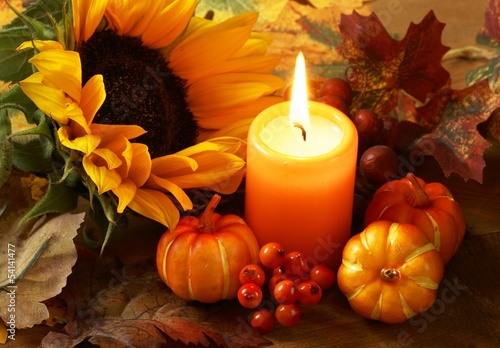 Arrangement of sunflower, candle and autumn decorations Poster