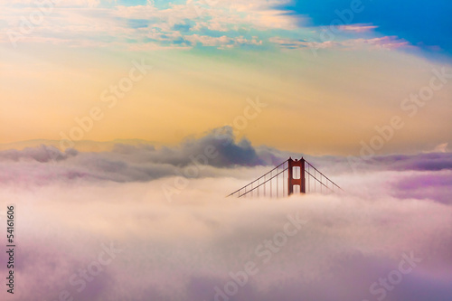 Poster San Francisco World Famous Golden Gate Bridge in thich Fog after Sunrise