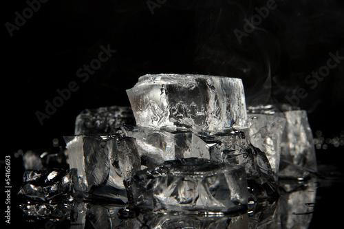 Photo  Ice cubes isolated on black