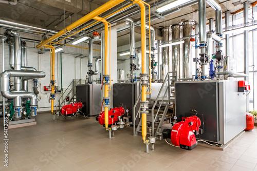 Fotografía  The interior of gas boiler, with three boilers.