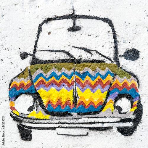 Street graffiti displays colorful car