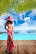 Woman by the swimming pool in luxury summer resort