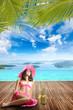 Woman at swimming pool deck in luxury summer resort in Greece
