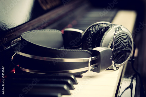 Piano keyboard and headphones, music concept.