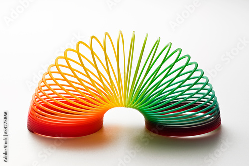 Poster Spirale Rainbow coloured slinky toy