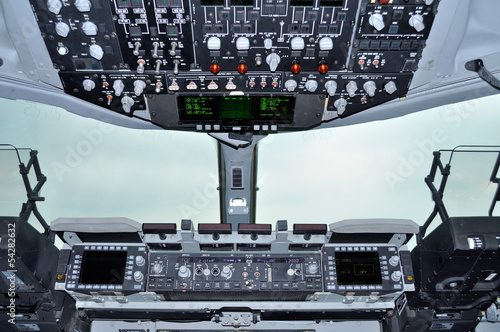 Fotografie, Obraz  Cockpit view inside the military transport aircraft