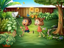 Two Friends Catching Butterflies At The Backyard