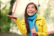 Autumn woman happy after rain walking umbrella