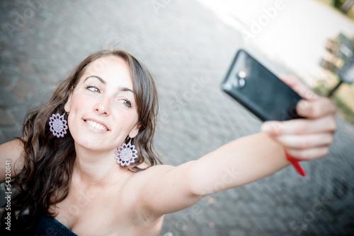 Obraz na plátně beautiful woman taking self-portrait