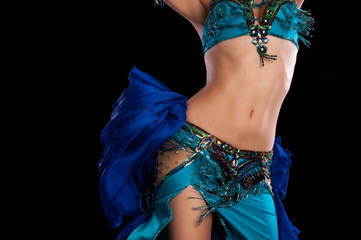 Fototapeta Do szkoły tańca Torso of a Bellydancer Shaking her Hips