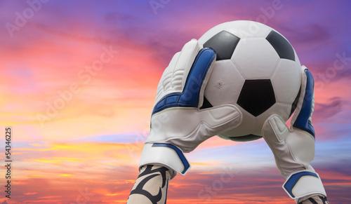 Fotografiet  Soccer goalkeeper's hands reaching for the ball