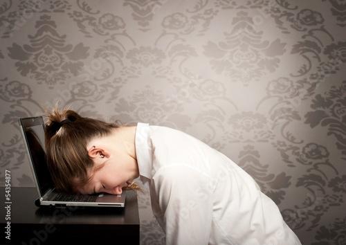 businesswoman sleeping on laptop Canvas Print