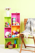 Colorful shelves of different colors with utensils near chair