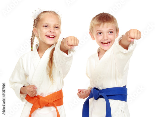 Garden Poster Martial arts Girl and boy in a kimono on a white background beat hand
