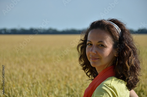 Fotografie, Obraz  girl with curly hair in wheat