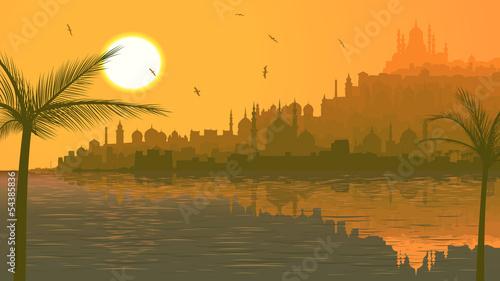 Fotografija Illustration of big arab city by sea at sunset.