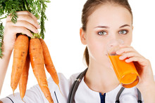 Female Doctor Holding Healthy Carrots.