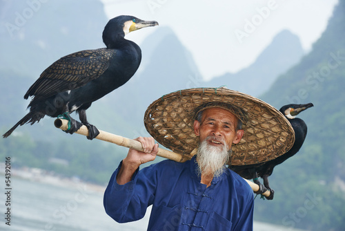 Foto op Aluminium Guilin Chinese old person with cormorant for fishing