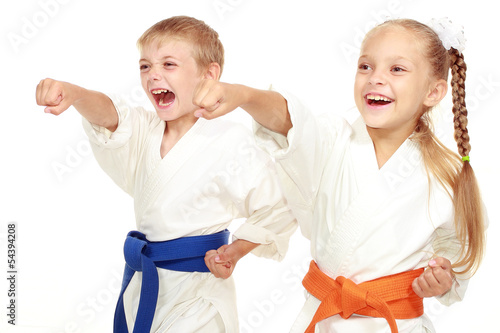 Photo Stands Martial arts Boy and girl in kimono beat hand