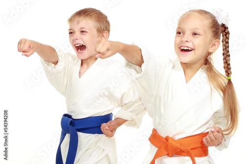 Garden Poster Martial arts Boy and girl in kimono beat hand