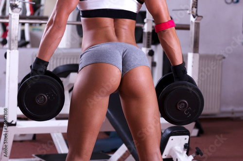 Tuinposter Ezel Very sexy young beautiful ass in thong at gym club