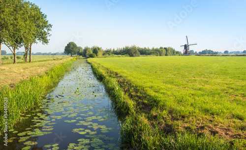 Fotografija Typical Dutch polder landscape with an old windmill