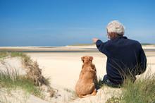 Man With Dog On Sand Dune