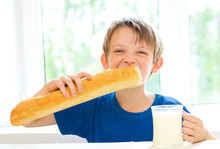 Boy With Milk And Long Loaf