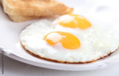 Deurstickers Gebakken Eieren Detail of plate with fried eggs and toasts