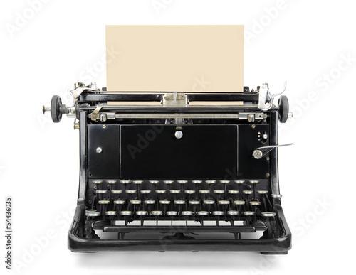 Maszyna do pisania z pustym prześcieradłem odizolowywającym na bielu Fototapeta