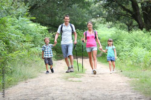 Fototapeta Family on a trekking day in countryside obraz