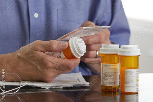 Photo Older man with prescription medications, horizontal