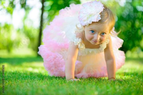 Fotografie, Obraz  Cute little girl in tutu at park