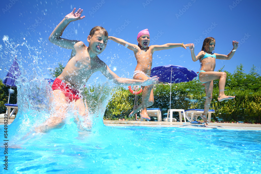 Fototapety, obrazy: Two little girls and boy fun jumping into swimming pool