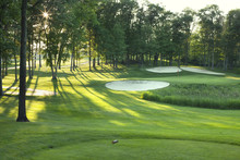 Golf Green And Tee Box In Late Afternoon Sunlight