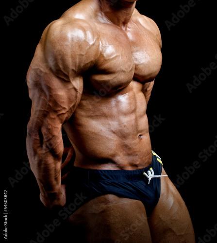 Fotografie, Obraz  Bodybuilder side chest pose