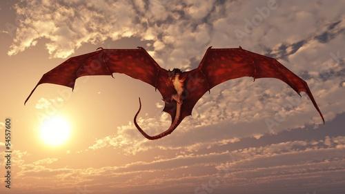 Naklejka premium Czerwony smok atakujący z Sunset Sky