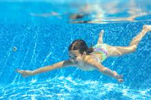 Happy Child Swims Underwater In Pool, Girl Having Fun